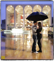 Smiling in the Rain (Ryan Brenizer) Tags: nyc wedding woman man love engagement nikon bokeh lincolncenter 85mmf14d d3s brenizermethod