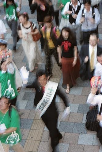 Takaaki Mitsuhashi walks on the road in Akihabara.