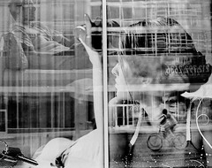 (Barry Yanowitz) Tags: nyc newyorkcity blackandwhite bw ny newyork reflection slr film bicycle 35mm reflections blackwhite manhattan trix d76 bicycles midtown transportation scanned canonae1 nycity selfdeveloped d76developer