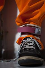 MUSCOGEE_3355 (skinmate) Tags: orange uniform jail jumpsuit inmate restraints