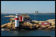 A Swedish outpost (Dan Wiklund) Tags: lighthouse house gteborg island sweden flag gothenburg cottage swedish sverige d200 scandinavia archipelago 2010 gefveskr gveskr