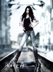 Straddling the Tracks (Poe Tatum) Tags: woman girl train dof boots bokeh tracks jeans