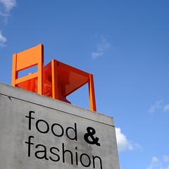 Almere: food fashion and a seat (Matthieu Verhoeven - Photographer -) Tags: orange town chair nikon matthieu shoppingmall stoel stad d3 oranje almere winkelcentrum verhoeven wwwmatthieuverhoevennl