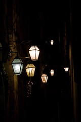 Lanterns dancing in the night (Celina Rocquet) Tags: ocean road light summer sky clock beach nature cemetery statue stone night clouds rocks waves buddha croatia pit well napkins lamps lantern messages dubrovnic mechanics croatie statuettes canoneos30d