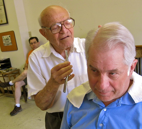 Frank Salemno, who turned 88 this week, shown here giving a haircut to long time customer Charlie Gallagher, received a citation from Philadelphia's Mayor for barbering at his shop in Chestnut Hill for seventy years!
