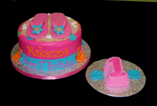Bright colored luau themed first birthday cake with flip flops and Smash Cake