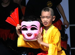 Shaolin Kid (ChrisGoldNY) Tags: nyc newyork newyorkcity queens flushing flushingmadow coronapark dragonboat summer gothamist asian hongkong creativecommonscentral karate shaolin people qns kids children masks yellow pink challengegamewinner challengegroupgame thechallengegame chrisgoldberg forsale albumcover bookcover chrisgoldny chrisgold chrisgoldphotos challengewinners thechallengefactory postcards posters life warmth alive greetingcards