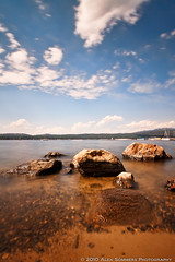 Long Exposure at Payette Lake, McCall Idaho (www.alexsommersphotography.com) Tags: longexposure blue summer sky bw lake water clouds canon eos boat movement rocks sailing id bluesky idaho clear 7d usm dslr efs 1022 mccall payettelake ndfilter daytimelongexposure neutraldensityfilter f354 bw77mm110neutraldensitynd30filter wwwalexsommersphotographycom