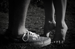 She stands up high on her tippy toes. (Mike Knapek) Tags: from white black love feet grass shoes kiss toes view angle legs you photos or small cuddle vans everyone laces cutex kissingx