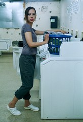 Sophia Washing 3 (neohypofilms) Tags: blue light white color slr film girl 35mm vintage hair asian japanese 50mm nikon shoes basket candid working machine retro exotic laundry slacks clogs ambient series casual mules washers slippers dryers pant rollups