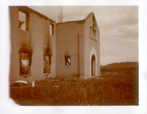 front of clark mansion- through fence