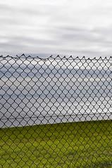 Confined (the english channel) (pni) Tags: uk sea england sky lighthouse green nature water grass fence point this cornwall unitedkingdom lizard peninsula skrubu pni uk10 theenglishchannel manandenvironment pekkanikrus