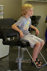 Silas waits his turn at the haircutters