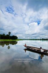 Tranquil Belai Bil (Ehtesham Khaled [www.ehteshamkhaled.com]) Tags: camera cloud lake reflection tree art water river lens boat cool nikon media crystal clear bil dhaka khaled depth ehtesham bangladesh bangla gazipur bpy advertise bangali banga belai parjaton sham619 gettyimagesbangladeshq3