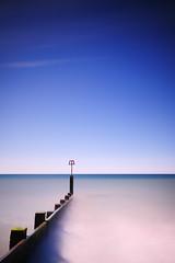 Blue (Stu Meech) Tags: morning blue light shadow sky bw beach nikon long exposure side hard sigma lee dorset cloudless 1020mm grad groyne bournemouth minamilism nd110 06nd d300s 09nd