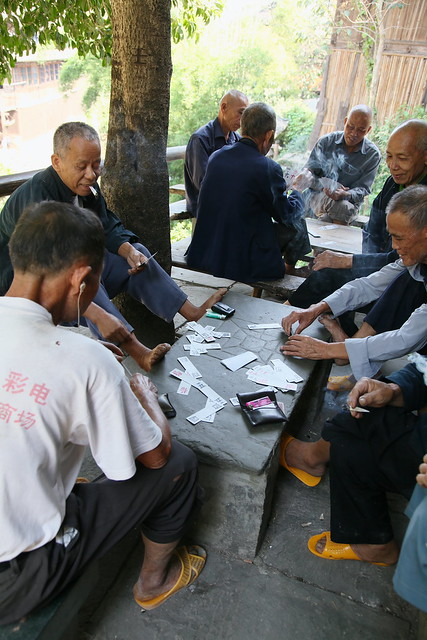 People playing card game, Chengyang, Guangxi, China