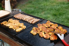 Aunt Yoke Ling's Turmeric Chicken, lamb and pork sausages on the BBQ