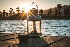 Sunset over the city (Burak Kebapci) Tags: city candle sea seaside beach palm tree trees sun sunset sunny sunflare lens kite sky