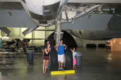 grandkids with a B-36 main landing gear. (BarryFackler) Tags: strategicaircommandandaerospacemuseum strategicaircommand sac unitedstatesairforce airforce usaf coldwar museum aircraft airplane ashland nebraska midwest ashlandne ashlandnebraska 2017 bomber heavybomber nuclearbomber convair b36jpeacemaker b36j peacemaker convairb36jpeacemaker convairb36j history militaryhistory magnesiummonster b36 convairb36 strategicintercontinentalbomber sn522217a katiefellbaum katie katielynnfellbaum jacquesliquie jacquestylerliquie jacques trevorjonfellbaumjr trevorfellbaum tjfellbaum tj veanna landinggear tires strut engines mainlandinggear barryfackler barronfackler vacation staticdisplay