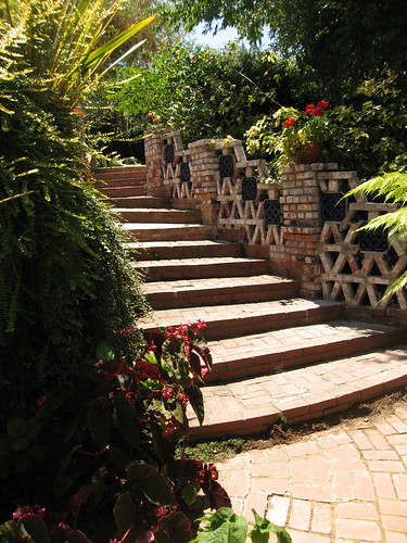 Stairs leading up from the rear patio.
