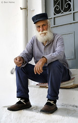 Old Man with Komboloi (Ben Heine) Tags: voyage street door trip travel art look hat fix beard photography eyes energy play hand pavement main pray oldman yeux moustache greece simplicity chapeau imaging conceptual simple rue discovery grce connection barbe naxos trottoir regard jeu barbu vibration komboloi lifetime prayerbeads culturel theartistery vieillard chapelet passthetime pallier creativecomposition benheine socialportrait anawesomeshot kompoloi orthodoxreligion relievestress samsungnx10 chemisecarreau be