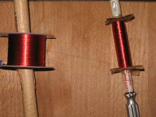 Shakeable dynamo: Spool the magnet wire on to the biro