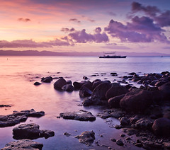 Sogod Bay 3 (Colleen Slater) Tags: sunset sea sky color colour nature water clouds landscape evening bay coast rocks asia view philippines peaceful colourful tranquil beautyinnature southernleyte napantao