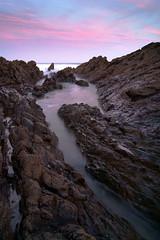 S u r r e a l (thills1988) Tags: longexposure morning pink reflection clouds landscape coast rocks purple surreal nd croyde dawnlight cokin nd9