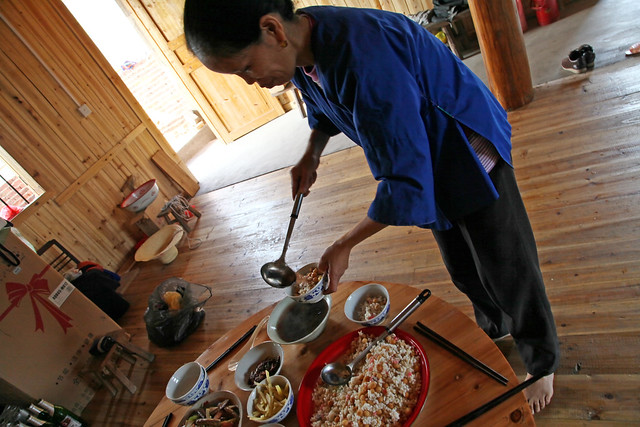 Setting the table for breakfast, Chengyang, Guangxi, China
