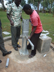 Irechero Women Group-attachment of water tank during pump installation.