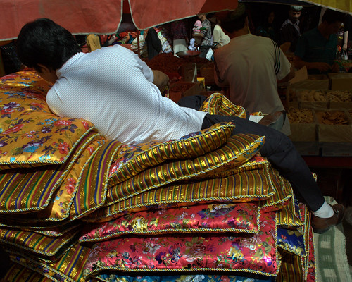 Sleeping Uighur at Hotan Sunday Market