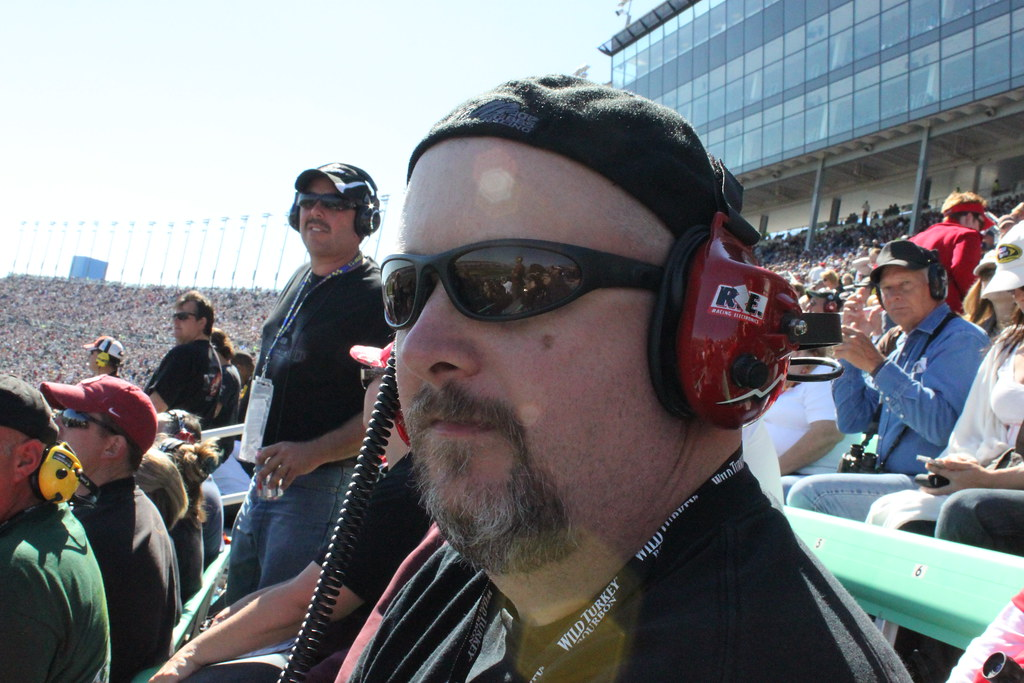 Brian watching and listening to the Price Chopper 400 at the Kansas Speedway