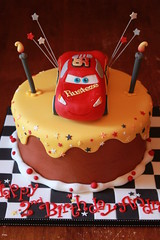 Lightening McQueen Drippy Icing Cake (Andrea's SweetCakes) Tags: birthday falg cakelightening mcqueendrippy icingcandlesstarscheckered