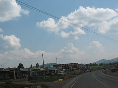 Dansons Books Centre (aaron.knox) Tags: africa road sky clouds buildings highway kenya powerlines shops fromacar kisii curver