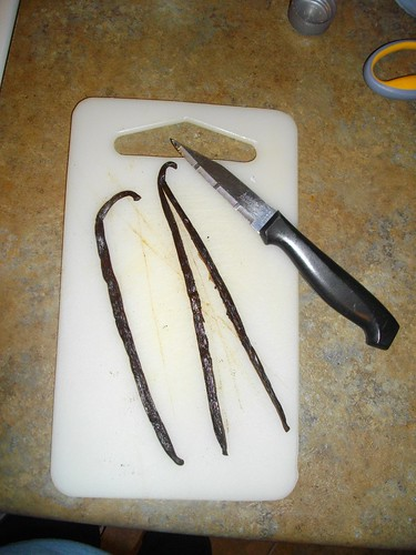 Split the vanilla beans in half