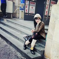 A Smoke and a Call... (antonkawasaki) Tags: portrait candid streetphotography squareformat crossedlegs 500x500 iphone4 prettyyoungwoman iphoneography ©antonkawasaki crossprocessapp girlsittingonstepssmokingcigaretteandlisteningtophone knithatandlegwarmers straightblackhairwithblondestreak arizonagreenteacan aikidoshinbudokai outsidenickelspaformen kneesshowingthroughstockings