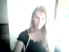 courtney in black ruffled shirt (lilbuttz) Tags: italy florence webcam courtney firenze internetcafe internettrain accentflorencespring2002
