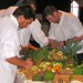 Chefs huddle over ingredients during Ashland Food and Wine Claasic competition