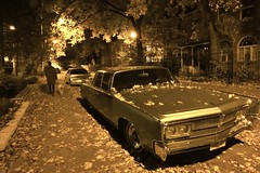 Chrysler Imperial on Halloween Eve (Roger Cullman) Tags: street autumn dog toronto fall halloween monochrome leaves car sepia night calendar cadillac imperial chrysler streetscape 65 jalopy dogwalking 1965 fallcolour wx1 TGAM:photodesk=fallcolour TGAM:photodesk=halloween