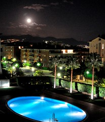 Moon over Sitges (keithhull) Tags: moon pool spain nightshot noflash catalunya sitges