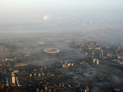 London 2012 Olympic site in fog (Frans Zwart) Tags: city uk london thames plane flying stadium aircraft zurich cockpit east olympic winglet pilot 2012 embraer lcy