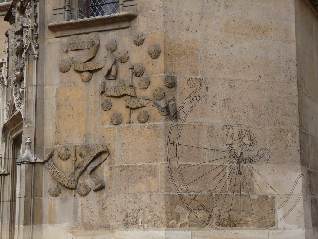 sundial and gothic decoration in courtyard of Musée de Cluny, Paris