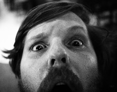 (JoeBenjamin) Tags: portrait bw hairy white man black guy art face up closeup nose lumix olympus dude panasonic filter surprise quizzical what shock 20mm mustache huh bearded attacked ep1 f17 m43 mft microfourthirds