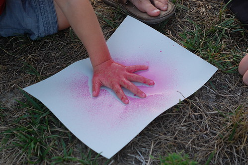 splatter painting a kid's hand