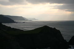 Light on a far shore (jurassic john) Tags: sea cliff cloud rock canon coast devon sunbeam westcountry eos400d absolutelystunningscapes dragondaggerphoto