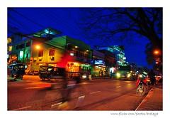 One Beautiful Moment in Vientiane (Araleya) Tags: life road street city blue light bicycle night composition moving colorful asia southeastasia capital lifestyle move poetic biking slowshutter feeling laos vientiane nkion araleya รถ ลาว d5000 ถนน laospdr flickrelite เวียงจันทร์ beautfiulmood sreetshot