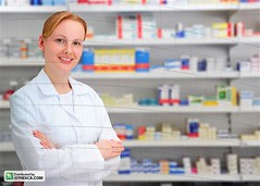 portrait of a female pharmacist at pharmacy (mauricio jordan) Tags: camera portrait woman smile smiling shop retail 30 standing work hair happy one store lab uniform looking adult coat small working shelf medical business indoors pharmacy health blond blonde distributed service medicine years copyspace drugstore healthcare mid pharmacist prescription confident 30s owner confidence 20s chemist caucasian occupation expertise 2530 isyndicariodejaneiroriodejaneirobrasil
