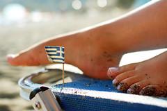 The flag and the feet (focuspocus) Tags: summer feet beach greek sand flag kreta august greece crete 2010
