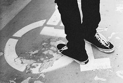 (dearest, nearest) Tags: boy blackandwhite black guy film feet skinny concrete shoes paint pentax space parking lot jeans converse 400 worn mx laces handicapped blackskinnyjeans
