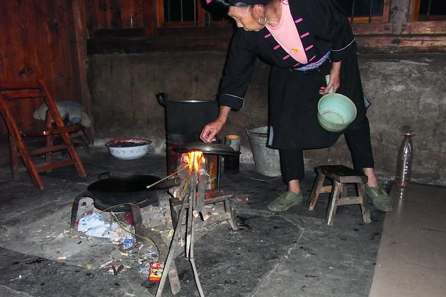 Yao woman preparing dinner, Guangxi, China